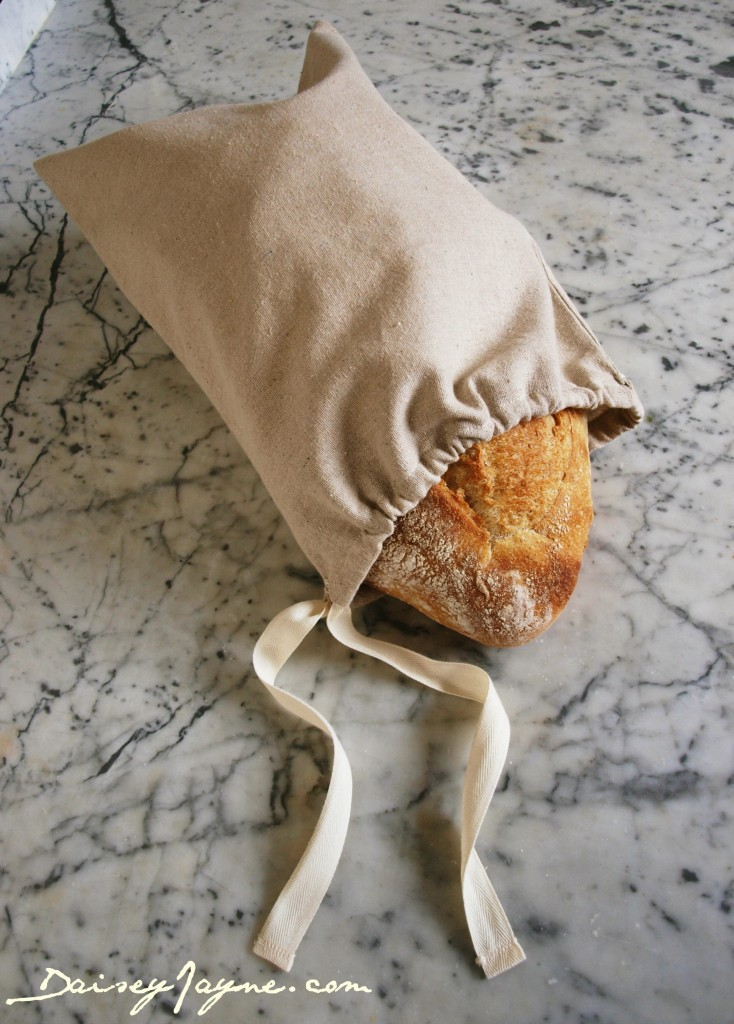 fresh baked bread in fabric bread bag