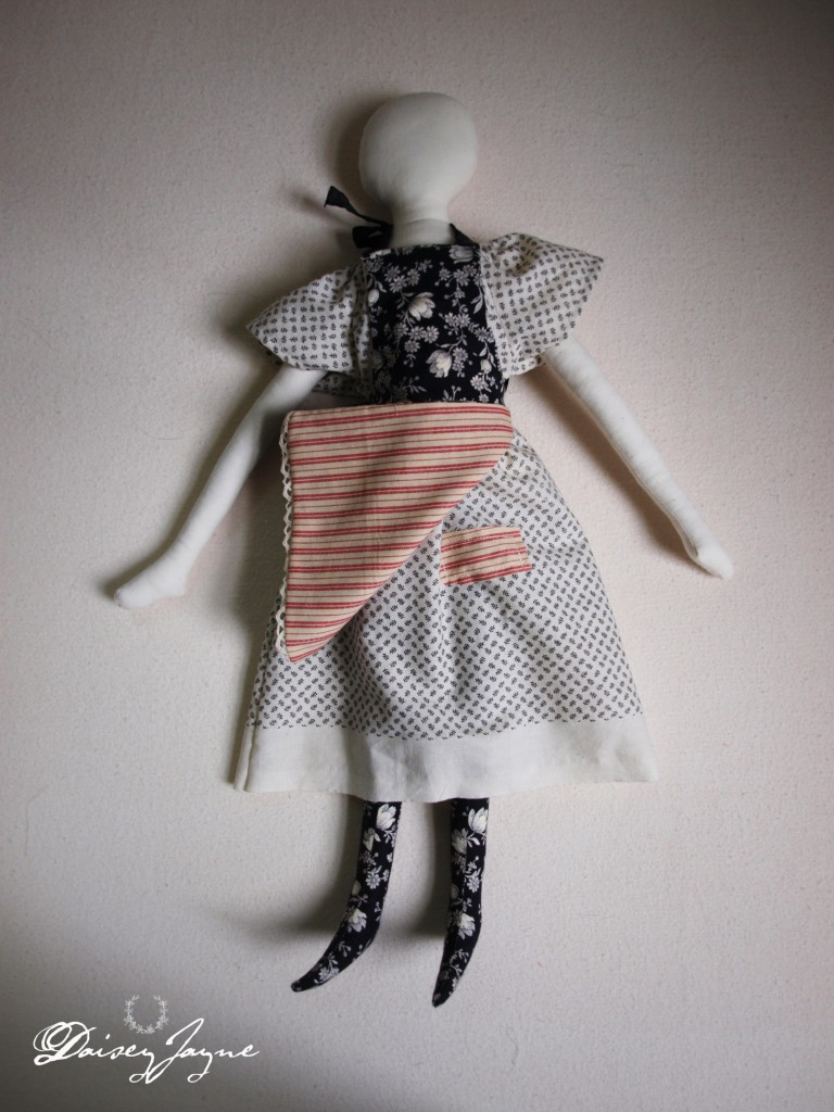 reversible apron and tiny patch on her dress
