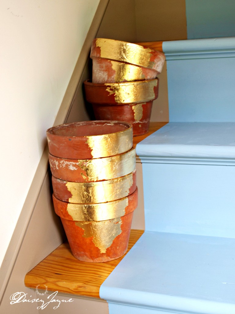 I put some gold leaf on these old terra cotta pots, I think they bring some much needed light to this corner of the house