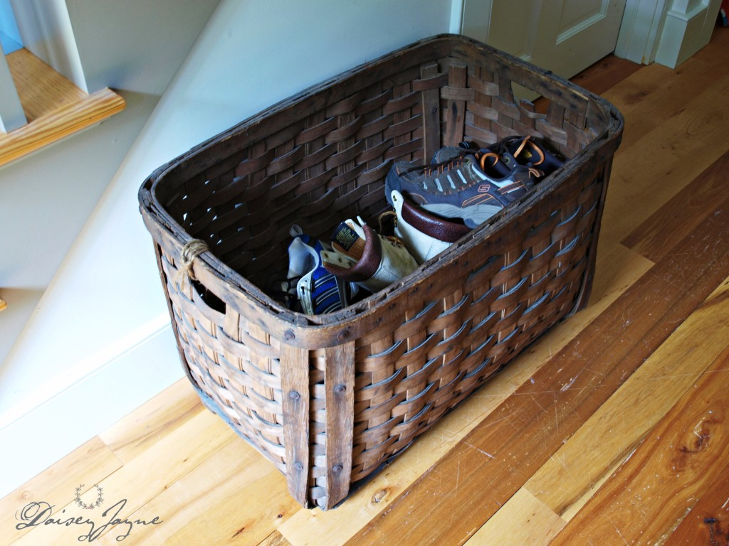 antique basket that's been in my family forever, it's very sturdy and we use it to hold shoes